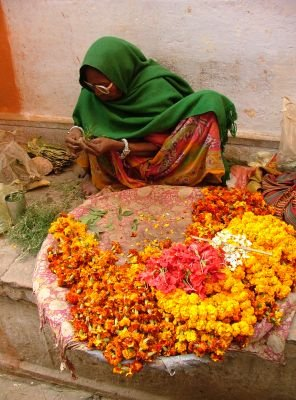 Indian woman selling flowers
